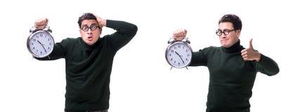 I giovani soldi del nerd con l'orologio gigante isolato su bianco immagini stock libere da diritti