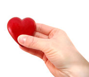 I give you my heart. Hand holding a heart isolated on white Stock Photography