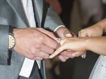 I give you this ring. Wedding couple exchanging rings during ceremony Royalty Free Stock Photography