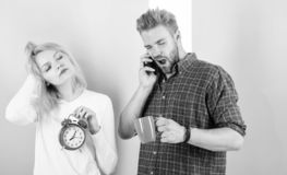 I am going late for work. Couple in love overslept morning alarm. Woman and man sleepy tousled hair drink morning coffee. I am going late for work. Couple in royalty free stock image