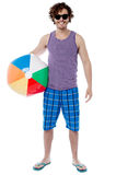 I going to play in beach. Handsome young guy posing with beach ball Stock Images
