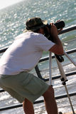 I got it !. Candid shot, photographer taking picture, ocean Royalty Free Stock Photography