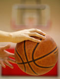 I got it 2. A player moving the basketball with blurred backboard Stock Photo