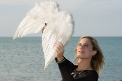 I got an angel!. A young woman with wings of an angel captured on the fly Stock Image