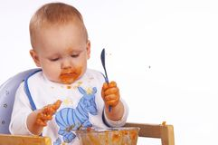 I got food all over. Young boy with lots of food on his fingers and around his mouth stock image