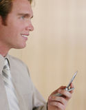 I got the job. Man using cellphone while looking forward Stock Image