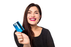 I got my new credit card !. Cheerful young woman showing her credit card Royalty Free Stock Image