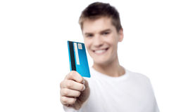 I got my new credit card. Male showing his credit card, focus on card Stock Photo