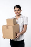 I got my parcels. Woman holding stack of carton boxes Royalty Free Stock Images