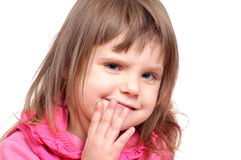 I got one secret. Little girl smiling with fingers on her lips Stock Photography
