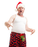 I Got Your Christmas Gift Right Here Baby. Humorous photo of a guy in boxer shorts with mistletoe over his crotch, asking for oral sex for Christmas. Isolated on royalty free stock photo