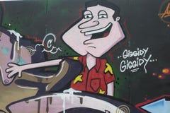 I graffiti sul negozio del boardedup nella galleria St George di acquisto della riduzione di attività `` camminano in Croydon Immagine Stock Libera da Diritti
