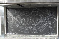 I graffiti sul negozio del boardedup nella galleria St George di acquisto della riduzione di attività `` camminano in Croydon Immagini Stock