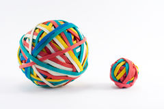 When i grow up. Big and small rubber band balls on white Stock Images