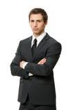 I halvfigur stående av affärsmannen med korsade armar Royaltyfri Bild