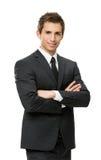 I halvfigur stående av affärsmannen med korsade händer Fotografering för Bildbyråer