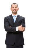 I halvfigur stående av affärsmannen med korsade händer Arkivfoton