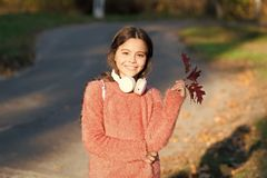 I am a happy kid. Happy little girl in autumn. Little music fan on autumn day. Little girl listen to music. Happy child stock photos