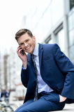 I am so happy to hear from you !. Image of a cheerful businessman talking on his cell phone stock photos