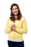 I am happy to see you friend !. Smiling mid woman welcoming with clasped hands Stock Photography