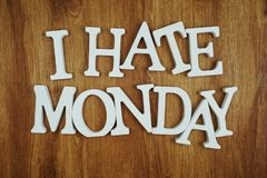 I Hate Monday alphabet letters on wooden background. I Hate Monday alphabet letters top view on wooden background stock photography