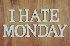 I Hate Monday alphabet letters top view on wooden background. Top view I Hate Monday alphabet letters on wooden background stock photos
