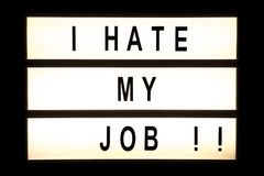 I hate my job hanging light box. Sign board royalty free stock photo