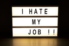I hate my job light box sign board. On wooden table stock photo