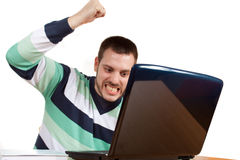 I Hate my Work. Man trying to smash his notebook with his fist Royalty Free Stock Photos