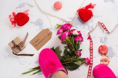 I hate Valentines day concept. After party mess with flowers, gift box, cookies and decorative hearts. Top view. Space for text Stock Photography