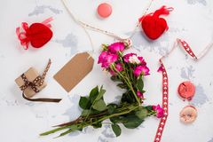 I hate Valentines day concept. After party mess with flowers, gift box, cookies and decorative hearts. Top view. Space for text Stock Photos