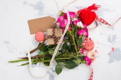 I hate Valentines day concept. After party mess with flowers, gift box, cookies and decorative hearts. Top view. Space for text Royalty Free Stock Image