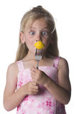 I hate veggies. Young girl looking with amazement at her veggies held on a fork Stock Image