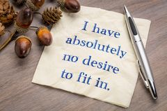 I have absolutely no desire to fit in. Handwriting on a napkin Royalty Free Stock Photo