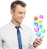 I have all my favorite apps on phone !. Business man checking his downloaded application on phone royalty free illustration