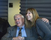 Howie Carr with a female fan. During book signing. 3-2-13 at WRKO Town Hall Event held at the WGBH auditorium Boston , Massachusetts- sponsored by Mass Firearms Royalty Free Stock Photo