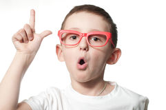 I have a good idea. Little cute  boy with glasses holding a finger up Royalty Free Stock Photos