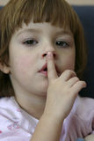 I have got a cold. Little girl touching her nose Stock Photo