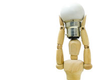I have an idea. Mannequin holding a light bulb against a white background Royalty Free Stock Photos