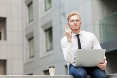 I have idea! Handsome ginger businessman with beard looking up and finger up. Outdoor shot Royalty Free Stock Photo