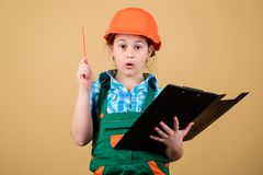 I have an idea. Safety expert. Future profession. small girl repairing in workshop. Child care development. Builder. Engineer architect. Kid worker in hard hat royalty free stock image
