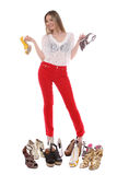 I have many shoes. Woman showing off her many shoes Stock Photo