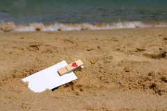 I have a message for you. HBlank business card wit peg with heart stamp in a sand at the beach Royalty Free Stock Image