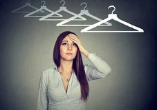 I have nothing to wear! Perplexed woman thinking what to dress Stock Photography