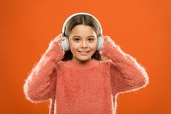 I have a soul for music. Cute girl child listening to music in stereo headphones. Small child enjoy music playing in. Earphones. Adorable little kid enjoying royalty free stock images
