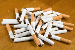 I have stopped to smoke. Broken cigarettes on a table Royalty Free Stock Photo