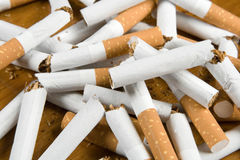 I have stopped to smoke. Broken cigarettes on a table Stock Photography
