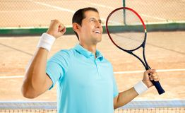 I have won this match. Portrait of a young male tennis player celebrating a victory on a clay court Stock Images
