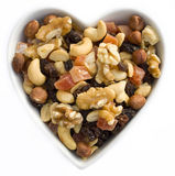 I heart fruits and nuts. Dried fruits and nuts in a heart shaped bowl Royalty Free Stock Photography