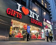 I Heart New York store. New York, January 27, 2017: People walk by an `I HEART NY` gifts and luggage store located near Times Square in Manhattan royalty free stock photo